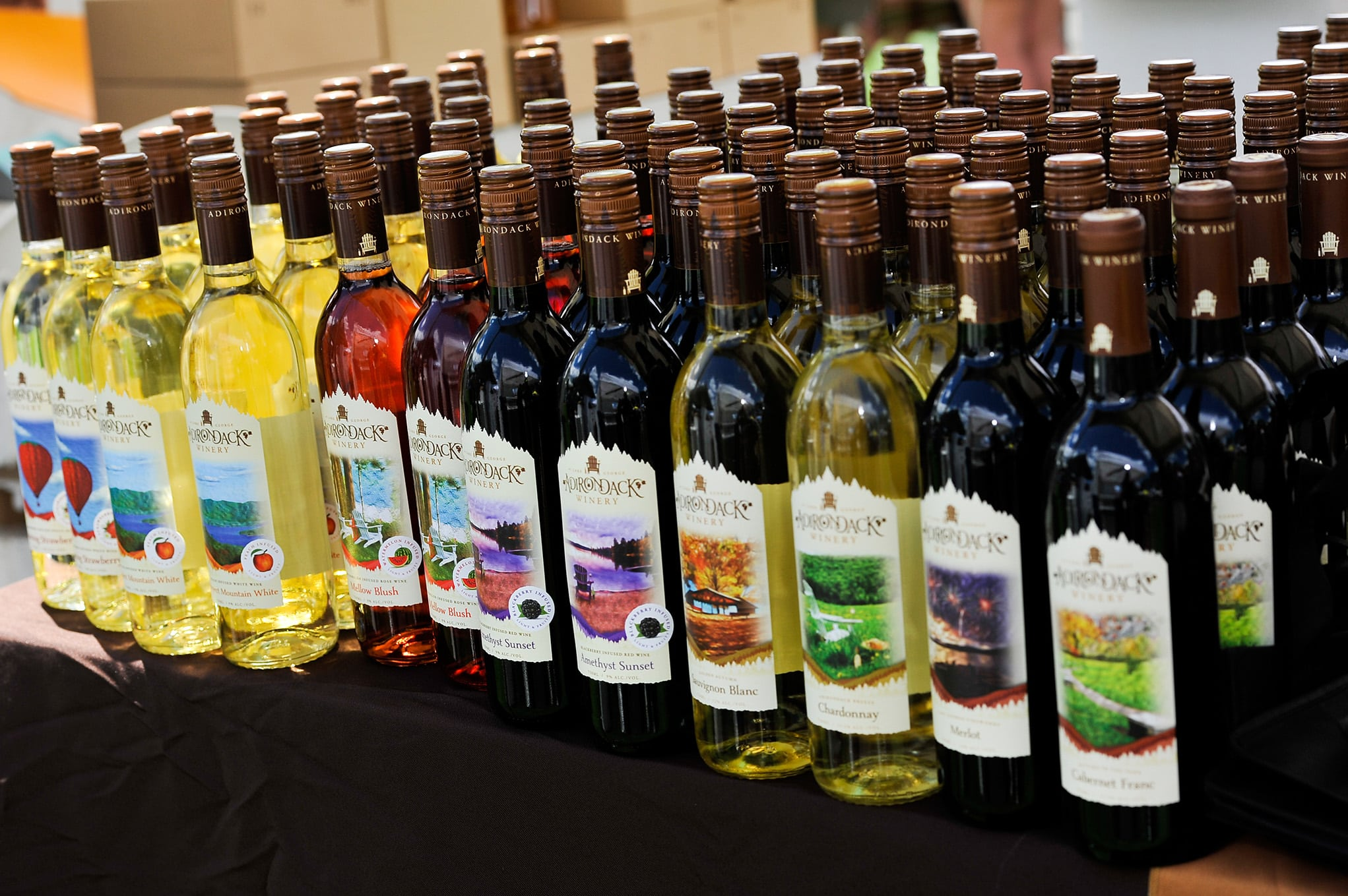adk winery wine bottles lines up to sell
